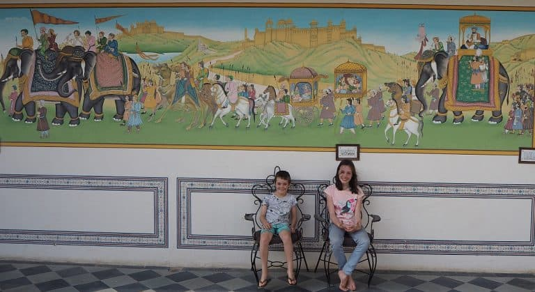 India, Mandawa havelli, kids sitting in front of a wall mural of an elephant parade