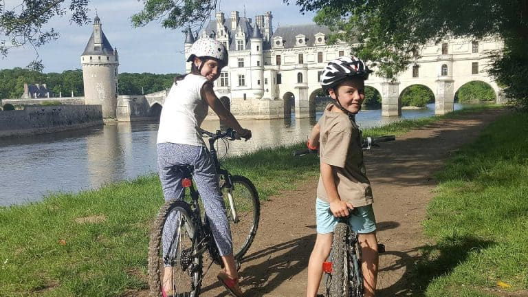 Europe by campervan with kids-cycling by Chateau Chenonceau France
