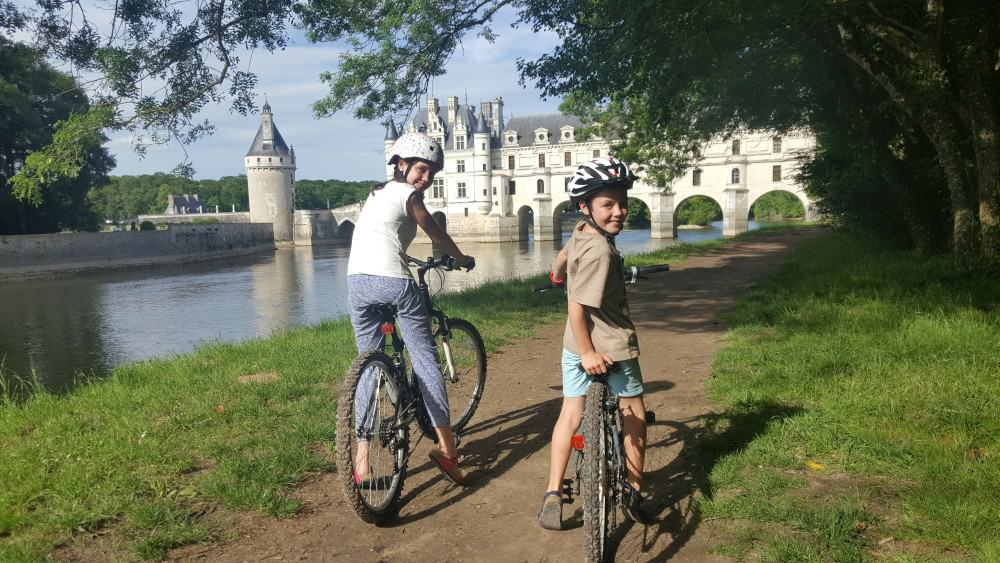 Amelie and Harvey on bikes in Chenonceau, France