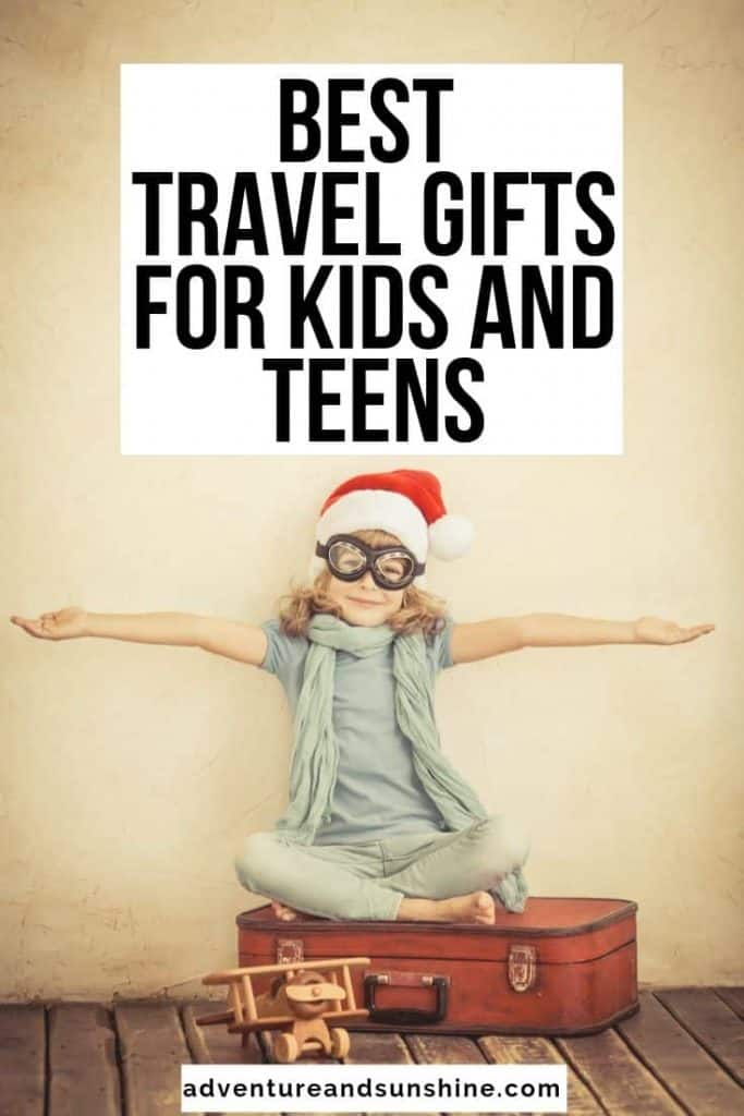 image of girl on suitcase with text overlay best travel gifts for kids and teens