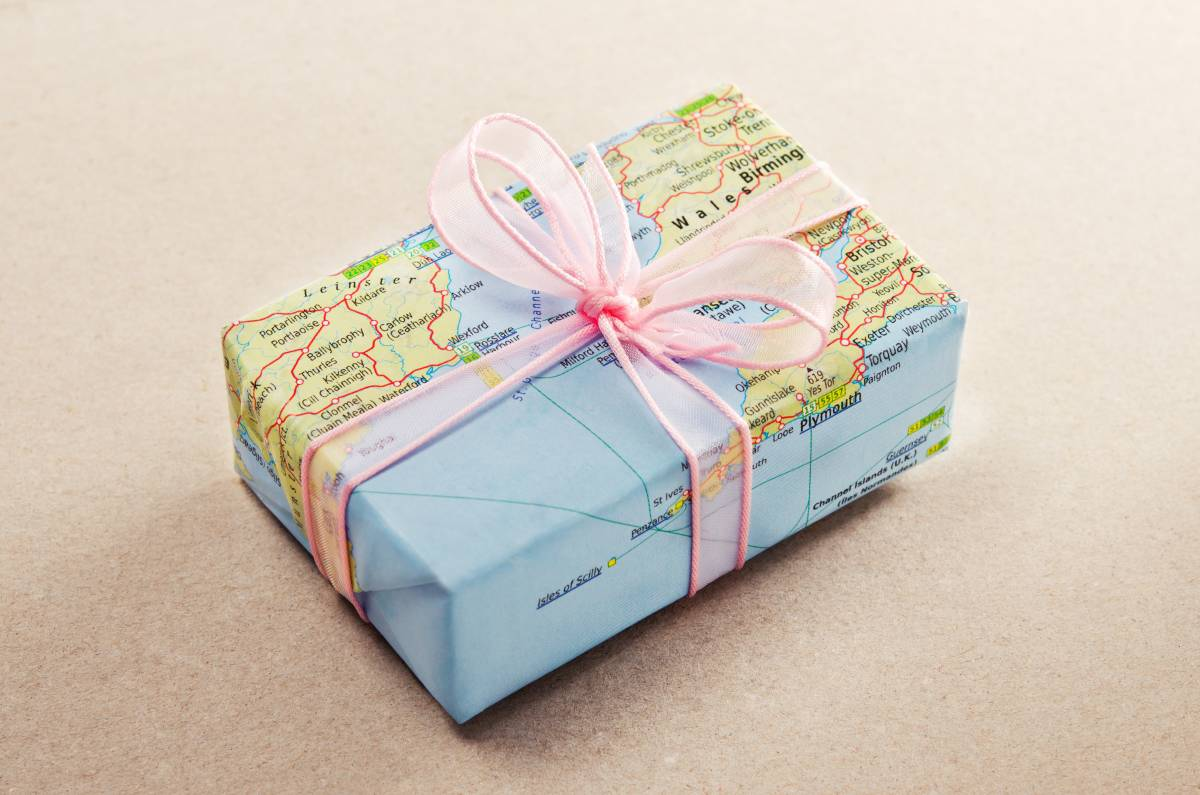 Gift wrapped in world map - best gifts for kids who travel