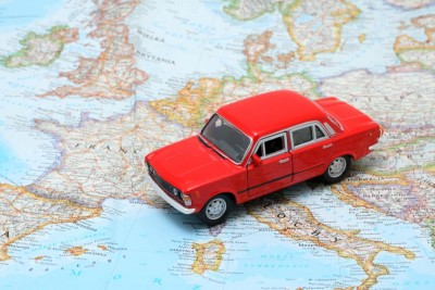 Red car on map - best road trip gifts for travel lovers