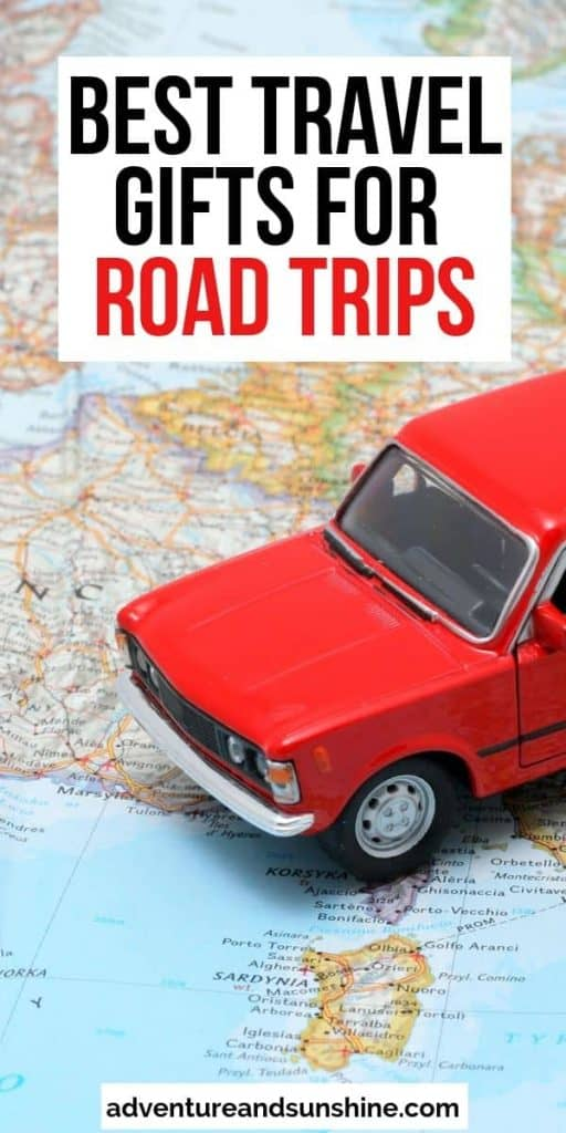 Close up of red car and map with text overlay - best travel gifts for road trips